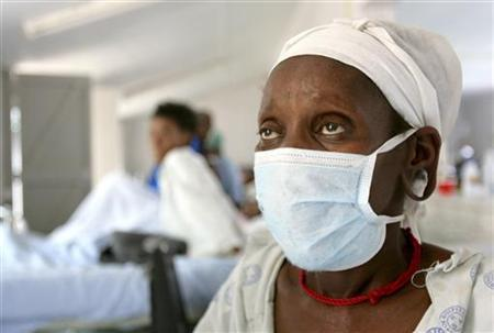 A patient who tested positive for extreme drug resistant tuberculosis (XDR-TB) awaits treatment at a rural hospital at Tugela Ferry in South Africa's impoverished KwaZulu Natal province, in this file photo taken October 28, 2006. REUTERS/Mike Hutchings/Files