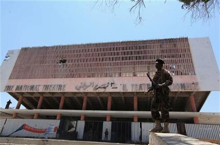 A soldier stands guard outside the national theatre during a visit by Somalia's President Sheik Sharif Ahmed, in the capital Mogadishu April 5, 2012. REUTERS/Feisal Omar