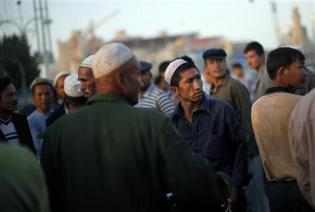 Uighur ethnic men gather at a corner of a market in Kashgar, Xinjiang province August 3, 2011. REUTERS/Carlos Barria