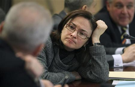 Minister of Economic Development Elvira Nabiullina (C) attends a commission on Russian economy modernization and technological development at Gazprom headquarters in Moscow December 25, 2009. REUTERS/Sergei Chirikov/Pool