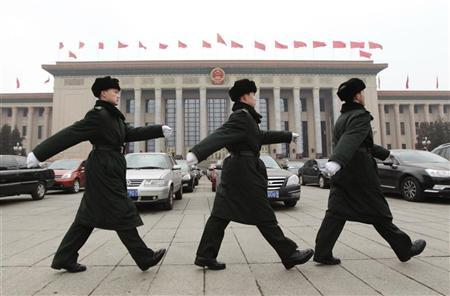 Soldiers of the Chinese People's Liberation Army (PLA) march in front of the Great Hall of the People, the venue of the National People's Congress or parliament, in Beijing March 2, 2012. REUTERS/Jason Lee