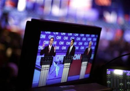 Republican presidential candidates (L-R) former U.S. Senator Rick Santorum (R-PA), former Massachusetts Governor Mitt Romney and former House Speaker Newt Gingrich are seen on a TV monitor as they participate in a Republican presidential candidates debate in Charleston, South Carolina, January 19, 2012. REUTERS/Jason Reed