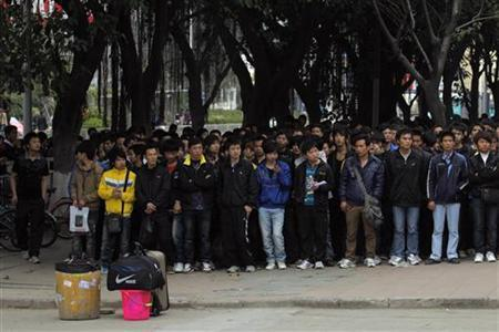 Employment seekers stand outside Foxconn in China's southern city of Shenzhen in Guangdong province, February 7, 2012. REUTERS/Tyrone Siu/Files