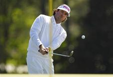 Bubba Watson of the U.S. chips onto the 18th green during second round play in the 2012 Masters Golf Tournament at the Augusta National Golf Club in Augusta, Georgia, April 6, 2012. REUTERS/Brian Snyder