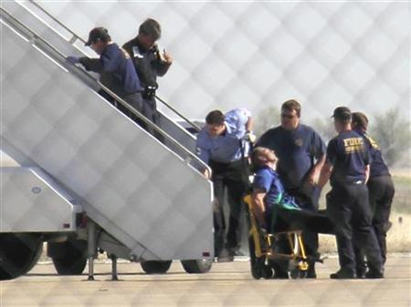 A JetBlue pilot captain Clayton Osbon, is removed from the plane after erratic behavior forced the crew to land in Amarillo, Texas, March 27, 2012. REUTERS/Steve Miller/The Reporters Edge