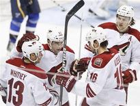 Phoenix Coyotes' players celebrate a goal by teammate Radim Vrbata (C) during the second period of their NHL hockey game against the St. Louis Blues in St. Louis, Missouri, April 6, 2012. REUTERS/Sarah Conard