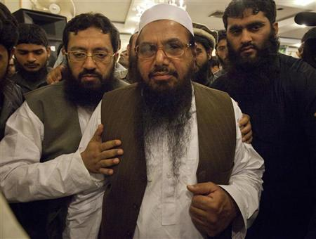 Hafiz Saeed, the head of Jamaat-ud-Dawa and founder of Lashkar-e-Taiba, is surrounded by his supporters as he leaves after a news conference in Rawalpindi near Islamabad April 4, 2012. REUTERS/Faisal Mahmood