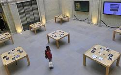 A customer views displays of Apple iPads tablet computers in central London March 16, 2012. REUTERS/Toby Melville