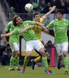 VfL Wolfsburg's Petr Jiracek (L) and Felipe Lopes (R) challenge Borussia Dortmund's Robert Lewandowski (C) during their German Bundesliga first division soccer match in Wolfsburg, April 7, 2012.  REUTERS/Fabian Bimmer