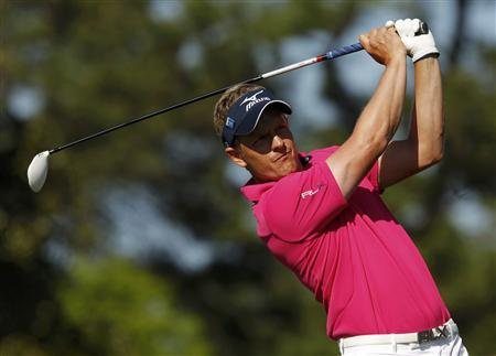 Luke Donald of England hits his tee shot on the 10th hole during second round play in the 2012 Masters Golf Tournament at the Augusta National Golf Club in Augusta, Georgia, April 6, 2012. REUTERS/Brian Snyder