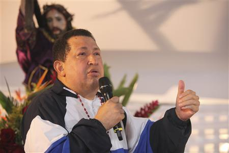 Venezuelan President Hugo Chavez attends a mass to pray for his health in his hometown of Barinas April 5, 2012. REUTERS/Handout/Miraflores Palace
