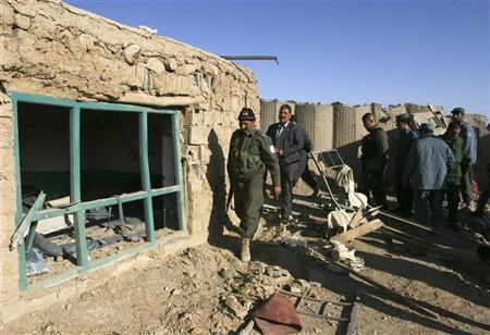 Afghan policemen inspect a police post after a night raid by U.S. troops in Ghazni province November 19, 2011. REUTERS/Mustafa Andaleb