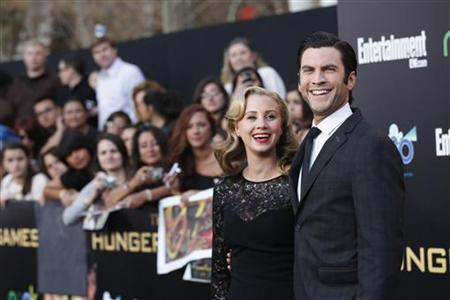 Cast member Wes Bentley and his wife Jacqui pose at the premiere of ''The Hunger Games'' at Nokia theatre in Los Angeles, California March 12, 2012. REUTERS/Mario Anzuoni/Files