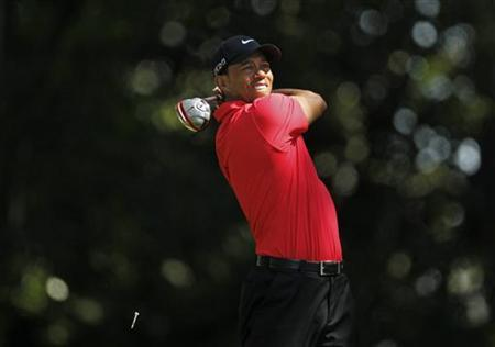 Tiger Woods of the U.S. hits his tee shot on the second hole during final round play in the 2012 Masters Golf Tournament at the Augusta National Golf Club in Augusta, Georgia, April 8, 2012. REUTERS/Mark Blinch