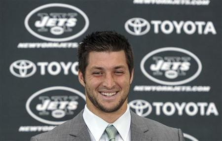 New York Jets quarterback Tim Tebow speaks at a news conference introducing him as a Jets at the team's training in Florham Park, New Jersey March 26, 2012. Tebow was traded to the Jets from the Denver Broncos last week. REUTERS/Ray Stubblebine