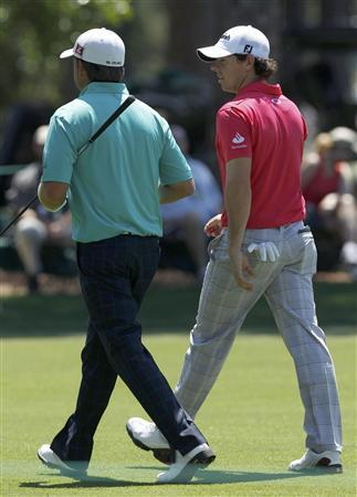 Rory McIlroy of Northern Ireland (R) walks with countryman Graeme McDowell up the first fairway during final round play in the 2012 Masters Golf Tournament at the Augusta National Golf Club in Augusta, Georgia, April 8, 2012. REUTERS/Mike Segar