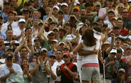 Bubba Watson of the U.S. (R) hugs his mother Mollie after winning the the 2012 Masters Golf Tournament at the Augusta National Golf Club in Augusta, Georgia, April 8, 2012. REUTERS/Mike Segar