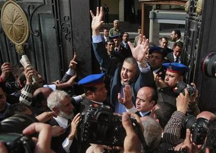 Presidential candidate from the Muslim Brotherhood, and the Freedom and Justice Party (FJP) Khairat al-Shater waves to his supporters after presenting recommendation documents to the Higher Presidential Elections Commission (HPEC) headquarters in Cairo April 5, 2012. REUTERS/Asmaa Waguih