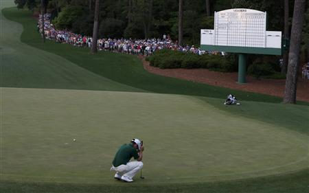 Louis Oosthuizen of South Africa reacts to missing a birdie putt on the 10th green during a playoff in the 2012 Masters Golf Tournament at the Augusta National Golf Club in Augusta, Georgia, April 8, 2012. Bubba Watson of the U.S. defeated Oosthuizen in the playoff to become the Masters champion. REUTERS-Phil Noble