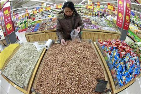 A customer chooses peanuts at a supermarket in Huaibei, Anhui province March 9, 2012. REUTERS/Stringer