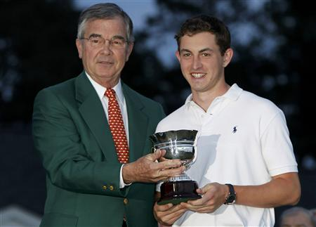 Top amateur Patrick Cantlay (R) of the U.S. receives his trophy from Augusta National Golf Club Chairman William Porter Payne after the 2012 Masters Golf Tournament at the Augusta National Golf Club in Augusta, Georgia, April 8, 2012. REUTERS/Mark Blinch
