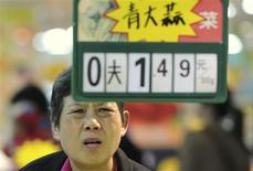 A customer reacts as she looks at a price tag at a supermarket in Hefei, Anhui province, April 9, 2012. China's annual inflation rebounded sharply in March to 3.6 percent, driven by rising food prices, data showed on Monday, surprising investors who had bet on cooling price pressures to give Beijing room to ease monetary policy. REUTERS/Stringer
