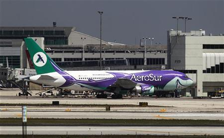 A Boeing 767 operated by Bolivian airline Aerosur sits at a gate at Miami's international airport, April 3, 2012. REUTERS/Rickey Rogers