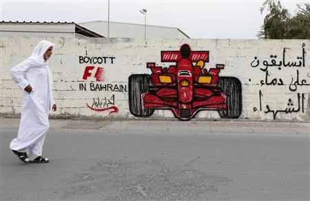 A man walks past anti-Formula One graffiti in the village of Barbar, west of Manama April 5, 2012. REUTERS/Hamad I Mohammed