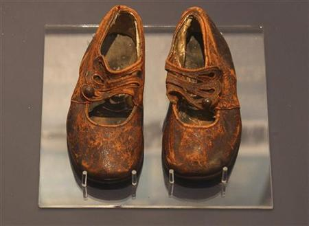 A child's shoes believed to be from the body of an unknown boy and recovered by the crew of the Mackay-Bennett, a cable-laying ship chartered by the White Star Line after the Titanic disaster, are seen in the Maritime Museum of the Atlantic in Halifax January 27, 2012. REUTERS/Paul Darrow/Files