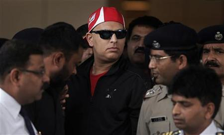 Cricketer Yuvraj Singh (wearing red cap) arrives at the Indira Gandhi International Airport in New Delhi April 9, 2012. REUTERS/Adnan Abidi