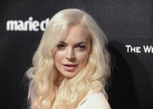 Actress Lindsay Lohan arrives at the The Weinstein Company after party following the 69th annual Golden Globe Awards in Beverly Hills, California January 15, 2012. REUTERS/Gus Ruelas