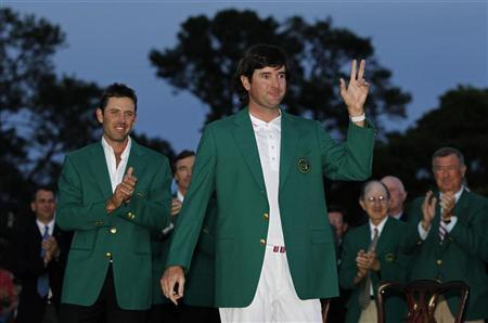 Bubba Watson of the U.S. (R) receives his green jacket from 2011 champion Charl Schwartzel (L) of South Africa after winning a playoff to become champion of the 2012 Masters Golf Tournament at the Augusta National Golf Club in Augusta, Georgia, April 8, 2012. REUTERS/Mark Blinch