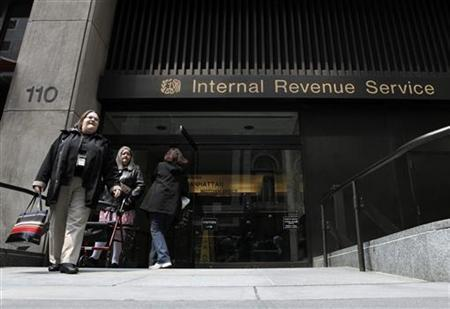 Women walk out of an Internal Revenue Service office in New York April 18, 2011. REUTERS/Lucas Jackson