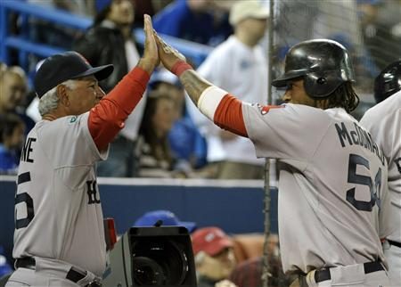 Boston Red Sox manager Bobby Valentine (L) and baserunner Darnell McDonald celebrate after scoring a run against the Toronto Blue Jays during the ninth inning of their MLB American League baseball game in Toronto April 9, 2012. REUTERS/Mike Cassese