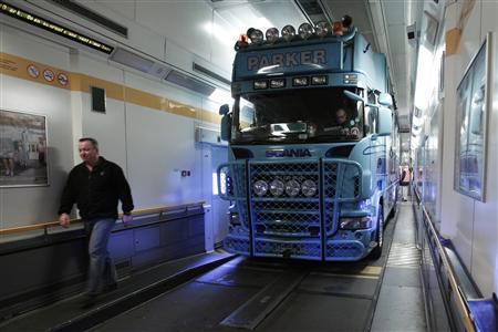 A lorry carrying competition horses is loaded into one of the Eurotunnel passenger shuttles in Calais to make the 35-minute crossing from France to the Britain, April 5, 2012. REUTERS/Gonzalo Fuentes
