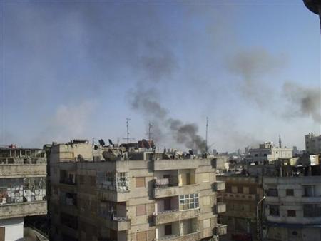 Smoke rises from the Al Qusoor district of Homs April 8, 2012. Picture taken April 8, 2012. REUTERS/Waseem Al Qusoor/Shaam News Network/Handout