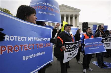 Obama healthcare legislation supporters rally on the sidewalk during the third and final day of legal arguments over the Patient Protection and Affordable Care Act at the Supreme Court in Washington, March 28, 2012. REUTERS/Jonathan Ernst