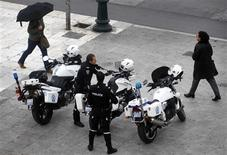 Greek police officers stand by their motorcycles in Athens' Syntagma square April 10, 2012. REUTERS/Yannis Behrakis