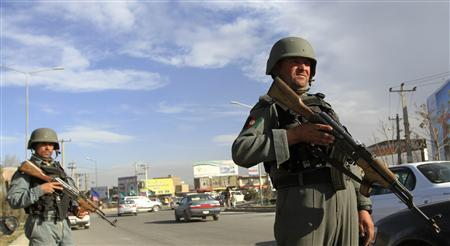 Afghan police keep watch at a checkpoint in Kabul April 10, 2012. REUTERS/Mohammad Ismail