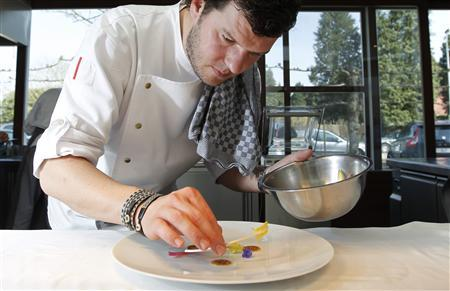 Belgian chef Gert De Mangeleer plates up a dish in the kitchen of Hertog Jan, the country's latest three-star Michelin restaurant, in Bruges March 29, 2012. REUTERS-Francois Lenoir