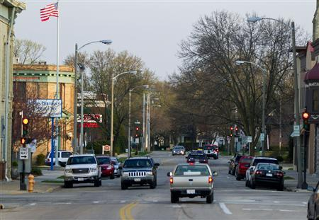 A view of a city street lined with cars in Janesville, Wisconsin, March 21, 2012. REUTERS/Darren Hauck