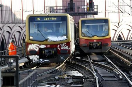 S-Bahn trains are seen outside of Alexander Platz station in Berlin December 15, 2011.   REUTERS/Fabrizio Bensch (GERMANY - Tags: TRANSPORT DISASTER)