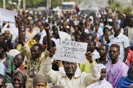 People from northern Mali march against the seizure or their home region by Tuareg and Islamist rebels, in the capital Bamako, April 10, 2012. REUTERS/Joe Penney