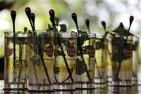 ''Mojitos'', a traditional drink mixed with rum, mint and sugar, are displayed at the Havana Club San Jose factory on the outskirts of Havana September 29, 2011. REUTERS/Desmond Boylan