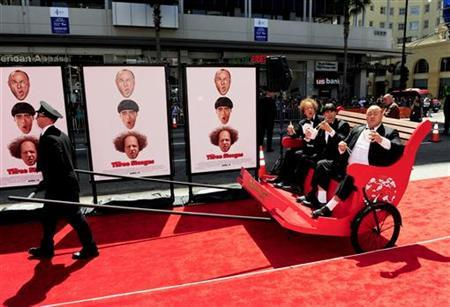 (L-R) Actors Sean Hayes who plays Larry, Chris Diamantopoulos who plays Moe and Will Sasso who plays Curly arrive in a rickshaw in character as the Three Stooges during the Hollywood premiere of ''The Three Stooges: The Movie'' in Los Angeles, California April 7, 2012. REUTERS/Gus Ruelas