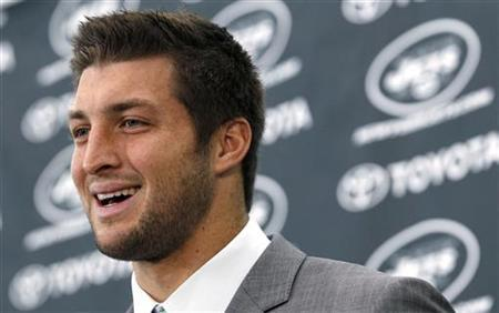 New York Jets quarterback Tim Tebow speaks at a news conference introducing him as a Jets at the team's training center in Florham Park, New Jersey March 26, 2012. REUTERS/Mike Segar