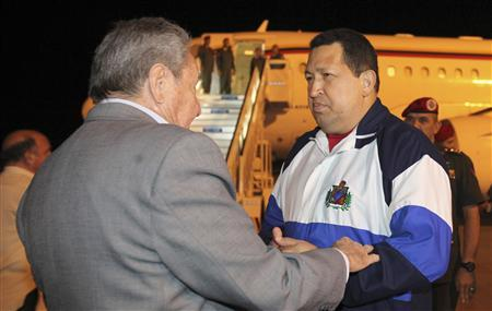 Venezuelan President Hugo Chavez (R) is welcomed at Havana's airport by his Cuban counterpart Raul Castro April 8, 2012. REUTERS/Miraflores Palace/Handout