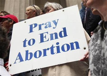 A pro-life supporter holds up a sign during a rally in New York March 23, 2012. REUTERS/Shannon Stapleton