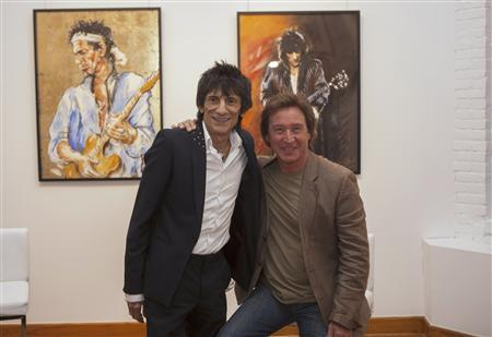 Rolling Stones guitarist Ronnie Wood (L) stands beside musician Kenney Jones during a news conference to discuss his ''Faces, Time and Places'' gallery show in New York April 9, 2012. The British guitarist known for his jamming skills with the bands such as ''The Faces'' and ''Rolling Stones'' along with his highly documented battles with alcoholism and drug abuse is also a trained visual artist. The exhibit titled ''Faces, Time and Places'' showcases Wood's finest work made over the period of four decades comprised of original paintings and sketches that are up for sale. REUTERS/Lucas Jackson
