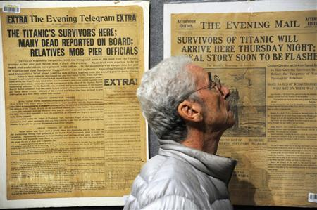 A visitor to the Bonham's auction house looks over antique newspaper headlines related to the sinking of the Titanic, on display in New York April 10, 2012. Bonham's will sell off items such as telegrams, books, newspapers, and replicas from the film 'Titanic''for the auction 'R.M.S. Titanic: 100 Years of Fact and Fiction' on Sunday, April 15, 2012. REUTERS/Keith Bedford